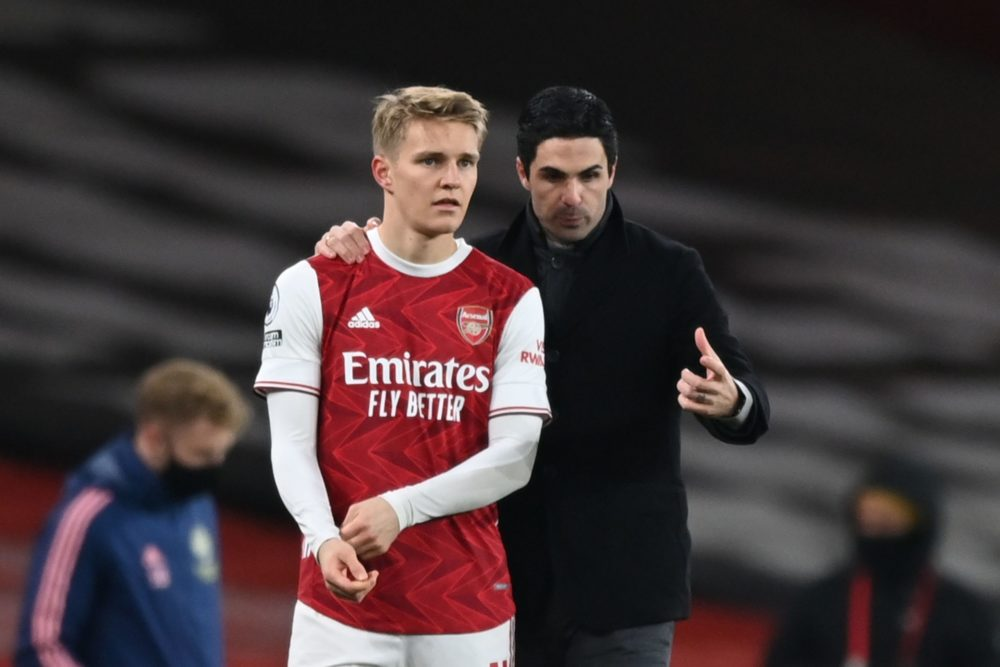 Arsenal deals: Arsenal's Norwegian midfielder Martin Odegaard (L) gets instructions from Arsenal's Spanish manager Mikel Arteta (R) as he comes on as a substitute during the English Premier League football match between Arsenal and Manchester United at the Emirates Stadium in London on January 30, 2021. (Photo by Shaun Botterill / POOL / AFP)