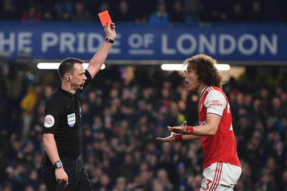 Referee Stuart Atwell (L) shows a red card to Arsenal's Brazilian defender David Luiz (R) to send him off for fouling Chelsea's English striker Tammy Abraham during the English Premier League football match between Chelsea and Arsenal at Stamford Bridge in London on January 21, 2020. (Photo by DANIEL LEAL-OLIVAS / AFP)