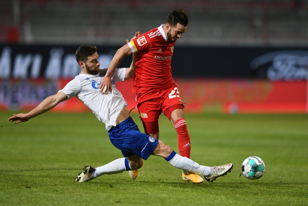 Schalke's German defender Shkodran Mustafi (L) and Union Berlin's German defender Niko Giesselmann vie for the ball during the German first division Bundesliga football match between 1 FC Union Berlin and FC Schalke 04 in Berlin on February 13, 2021. (Photo by ANNEGRET HILSE/POOL/AFP via Getty Images)
