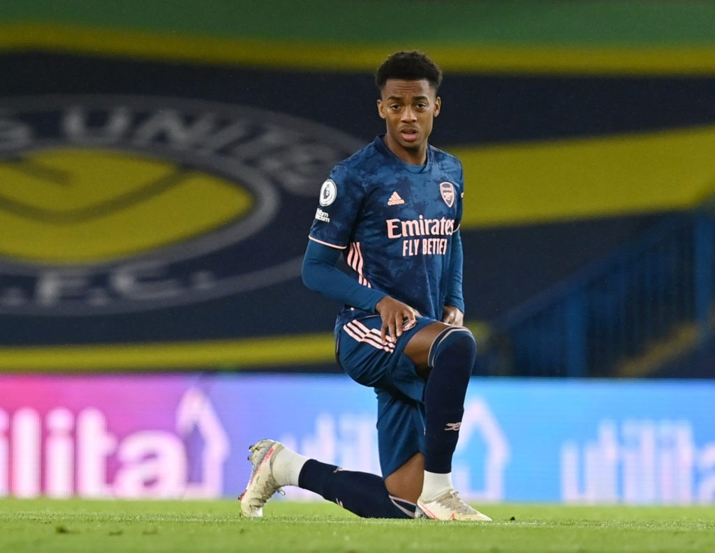 LEEDS, ENGLAND - NOVEMBER 22: Joe Willock of Arsenal takes the knee ahead of kick off during the Premier League match between Leeds United and Arsenal at Elland Road on November 22, 2020 in Leeds, England. Sporting stadiums around the UK remain under strict restrictions due to the Coronavirus Pandemic as Government social distancing laws prohibit fans inside venues resulting in games being played behind closed doors. (Photo by Paul Ellis - Pool/Getty Images)