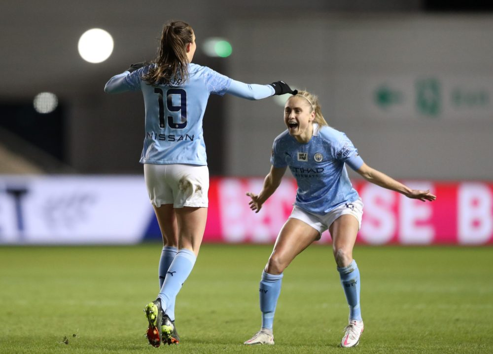 MANCHESTER, ENGLAND - FEBRUARY 12: Caroline Weir of Manchester City celebrates scoring her sides third goal with Steph Houghton of Manchester City during the Barclays FA Women's Super League match between Manchester City Women and Manchester United Women at Manchester City Football Academy on February 12, 2021 in Manchester, England. Sporting stadiums around the UK remain under strict restrictions due to the Coronavirus Pandemic as Government social distancing laws prohibit fans inside venues resulting in games being played behind closed doors. (Photo by Naomi Baker/Getty Images)