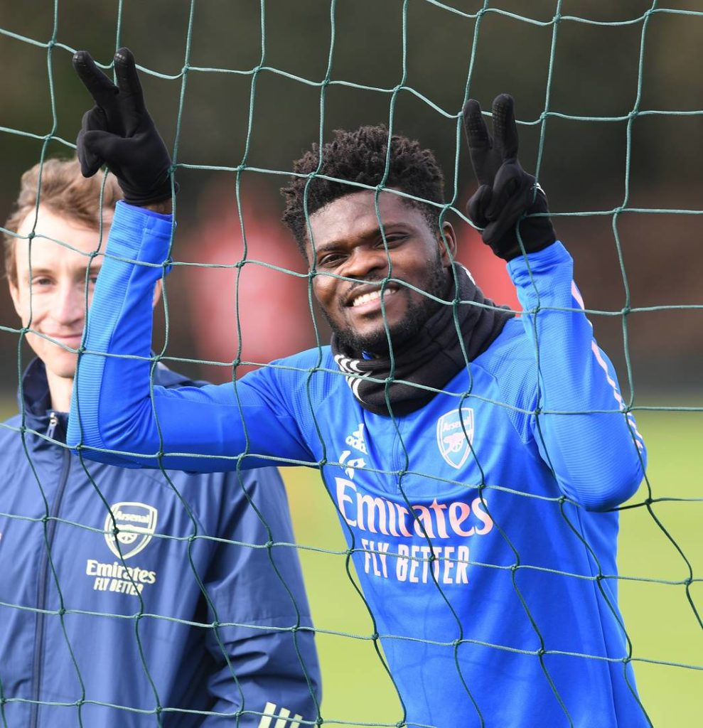 Thomas Partey watching on at Arsenal training