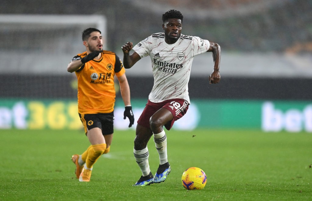 WOLVERHAMPTON, ENGLAND: Thomas Partey of Arsenal runs with the ball during the Premier League match between Wolverhampton Wanderers and Arsenal at Molineux on February 02, 2021. (Photo by Shaun Botterill/Getty Images)
