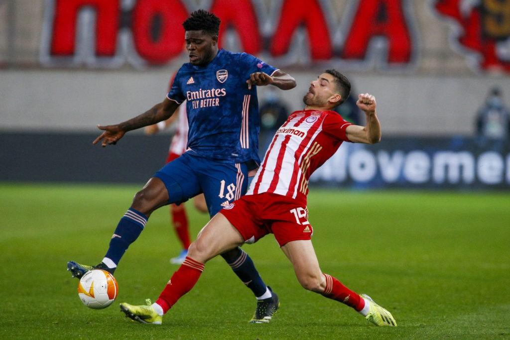 Thomas Partey of Arsenal battles for possession with Giorgos Masouras of Olympiacos during the UEFA Europa League match at Karaiskakis Stadium, Piraeus. Copyright: Focus Images