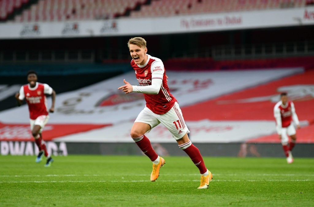 Martin Odegaard celebrates scoring their side s first goal of the game during the Premier League match at Emirates Stadium, London. Picture date: Sunday March 14, 2021. Copyright: Nick Potts