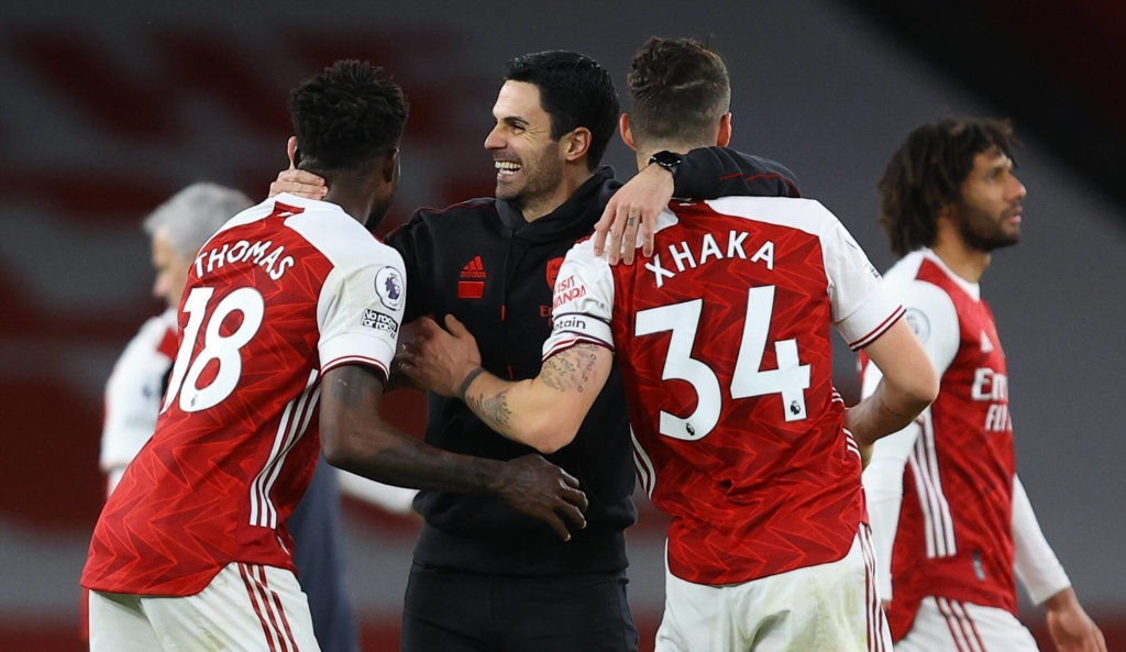 Arsenal v Tottenham Hotspur - Premier League - Emirates Stadium Arsenal manager Mikel Arteta centre celebrates with Thomas Partey left and Granit Xhaka after the Premier League match at Emirates Stadium, London. Picture date: Sunday March 14, 2021. Copyright: xulian Finney