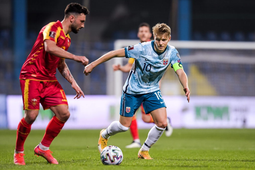 Sead Haksabanovic of Montenegro and Martin Odegaard of Norway during the FIFA World Cup Qualifier football match between Montenegro and Norway on March 30, 2021. Photo: Vegard Wivestad Grott / BILDBYRAN