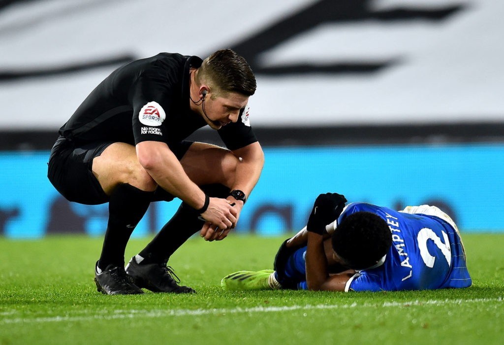 Craven Cottage Referee Robert Jones (left) speaks to Brighton and Hove Albion's Tariq Lamptey after he goes down injured during the Premier League match at Craven Cottage, London. Copyright: Glyn Kirk