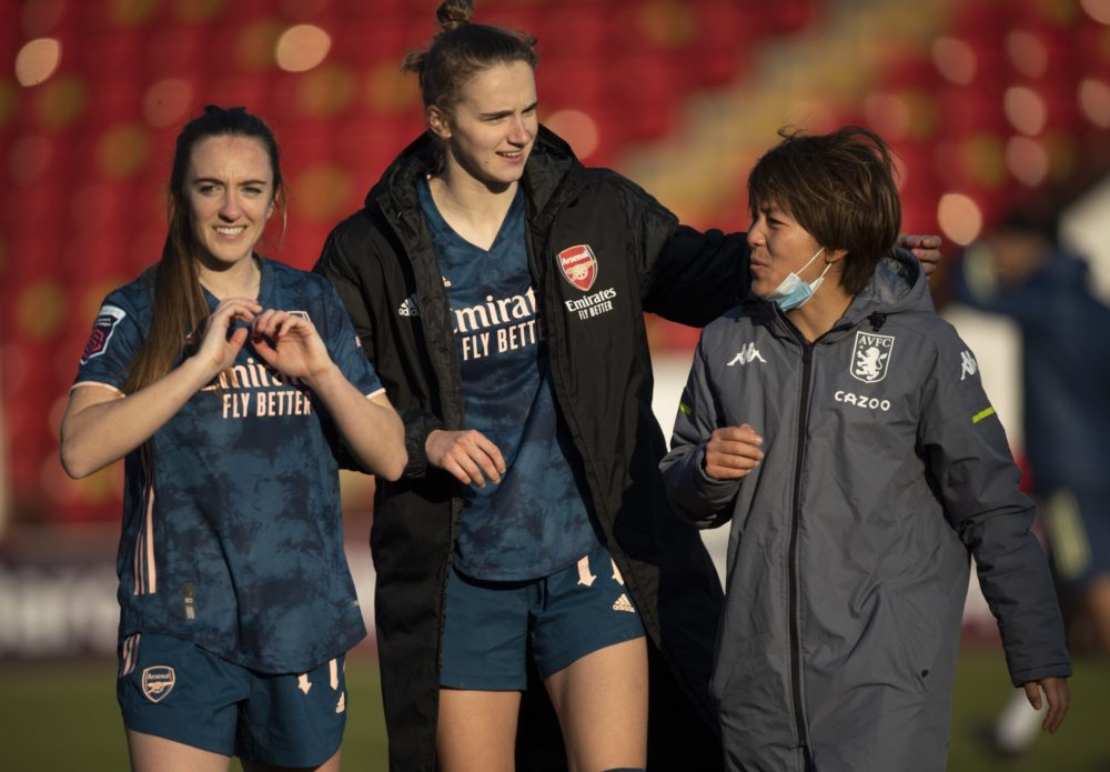 WALSALL, ENGLAND - FEBRUARY 28: Lisa Evans and Vivianne Miedema of Arsenal chat with Mana Iwabuchi of Aston Villa after the Barclays FA Women's Super League match between Aston Villa Women and Arsenal Women at Banks's Stadium on February 28, 2021 in Walsall, England. Sporting stadiums around the UK remain under strict restrictions due to the Coronavirus Pandemic as Government social distancing laws prohibit fans inside venues resulting in games being played behind closed doors. (Photo by Visionhaus/Getty Images)