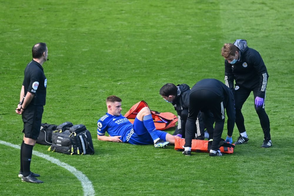 Leicester City's English midfielder Harvey Barnes is treated by medical staff after picking up an injury during the English Premier League football match between Leicester City and Arsenal at King Power Stadium in Leicester, central England on February 28, 2021. (Photo by Michael Regan / POOL / AFP)