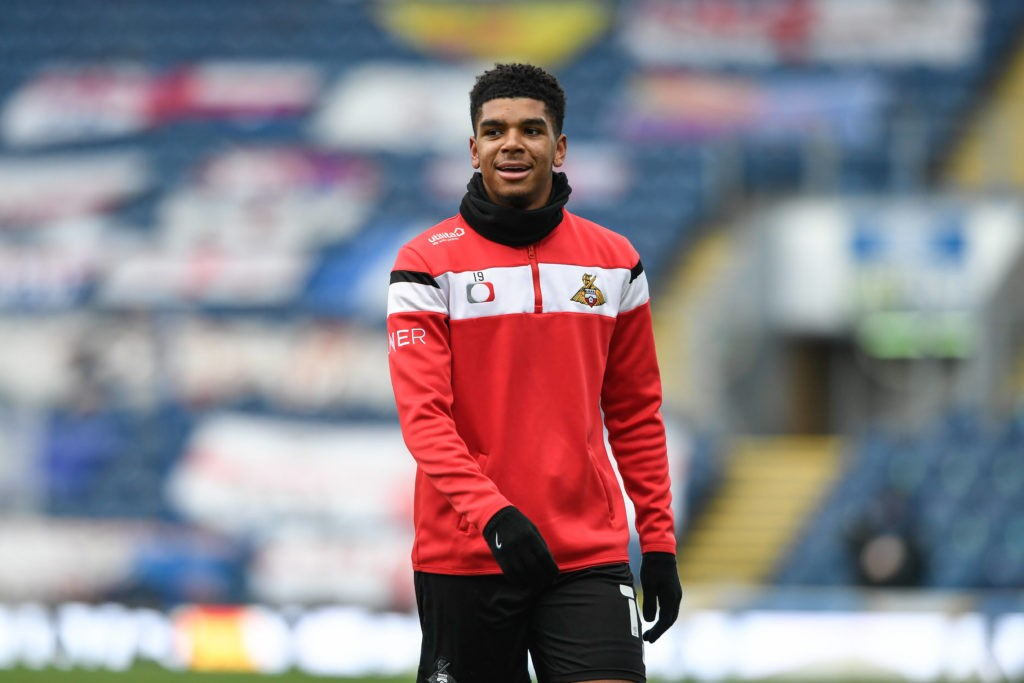 Tyreece John Jules of Doncaster Rovers warming up before the game on 9th January 2021. Copyright: Simon Whitehead / News Images / Shutterstock