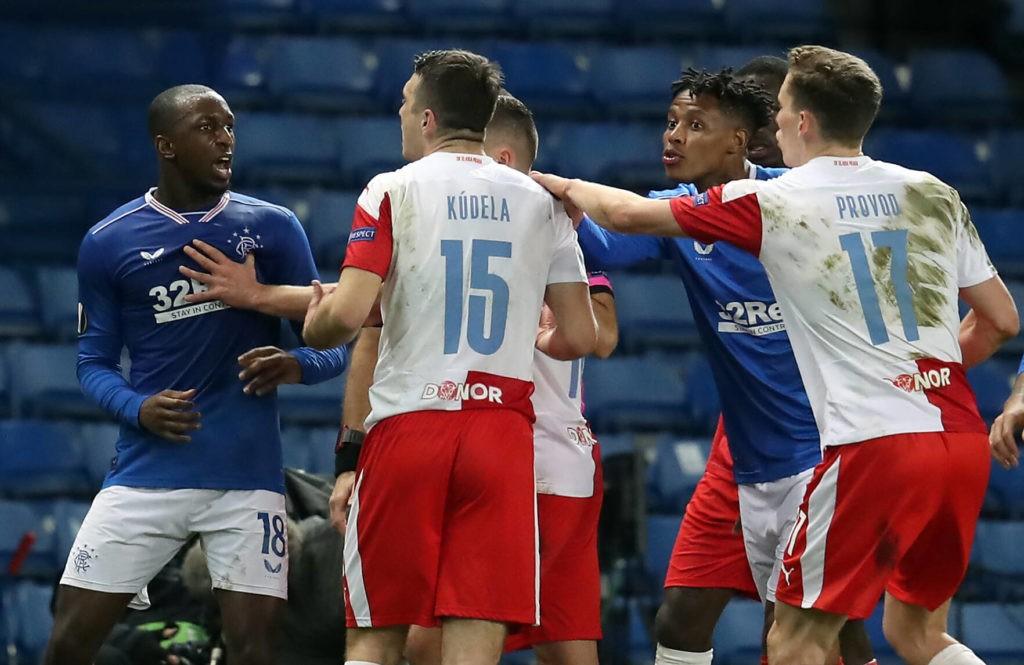 Rangers' Glen Kamara (left) argues with Slavia Prague's Ondrej Kudela during the UEFA Europa League Round of Sixteen match at Ibrox Stadium, Glasgow. Issue date: Tuesday, April 6, 2021. Copyright: Andrew Milligan