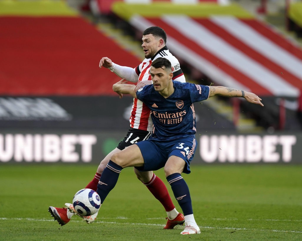 Sheffield, England, 11th April 2021. Oliver Burke of Sheffield Utd tussles with Granit Xhaka of Arsenal during the Premier League match at Bramall Lane, Sheffield. Picture credit: Andrew Yates / Sportimage