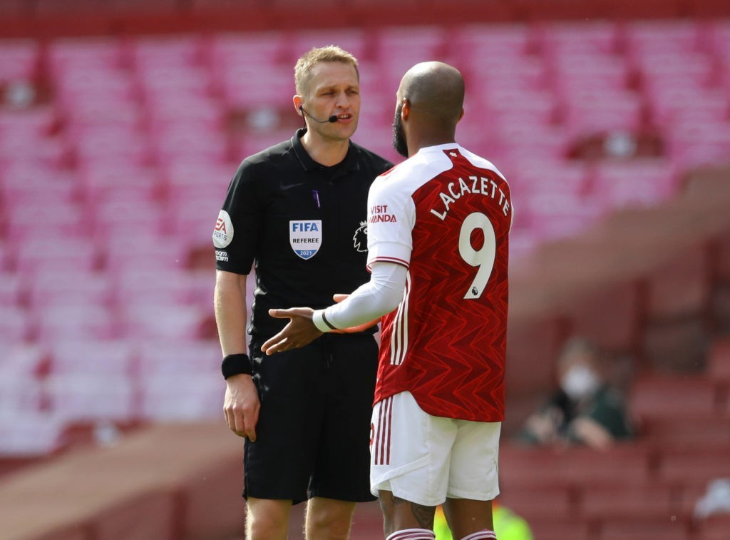 London, England, 18th April 2021. Referee Craig Pawson talks to Alexandre Lacazette of Arsenal during the Premier League match at the Emirates Stadium, London. Picture credit: David Klein / Sportimage