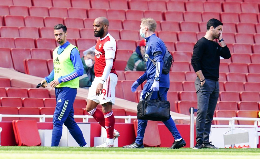 Alexandre Lacazette of Arsenal goes off injured past manager Mikel Arteta Arsenal v Fulham, Premier League, Football, The Emirates Stadium, London, UK - 18 Apr 2021 Photo by Javier Garcia/BPI/Shutterstock