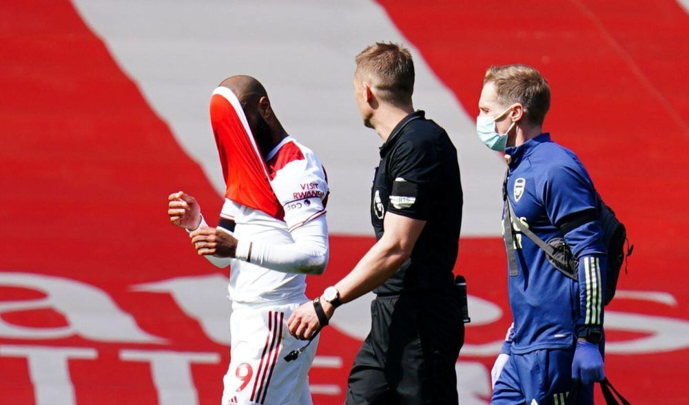 Alexandre Lacazette of Arsenal covers his face with his shirt as he goes off injured Arsenal v Fulham, Premier League, Football, The Emirates Stadium, London, UK - 18 Apr 2021 Photo by Javier Garcia/BPI/Shutterstock