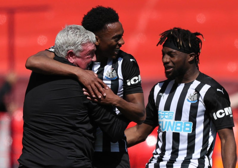 Joe Willock of Newcastle United celebrates with Newcastle United manager Steve Bruce after scoring in added time to level the score at 1-1 ActionPlus David Blunsden