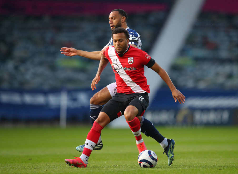 Southampton's Ryan Bertrand left and West Bromwich Albion's Matt Phillips battle for the ball during the Premier League match at The Hawthorns, West Bromwich. Picture date: Monday, April 12, 2021. Copyright: Catherine Ivill