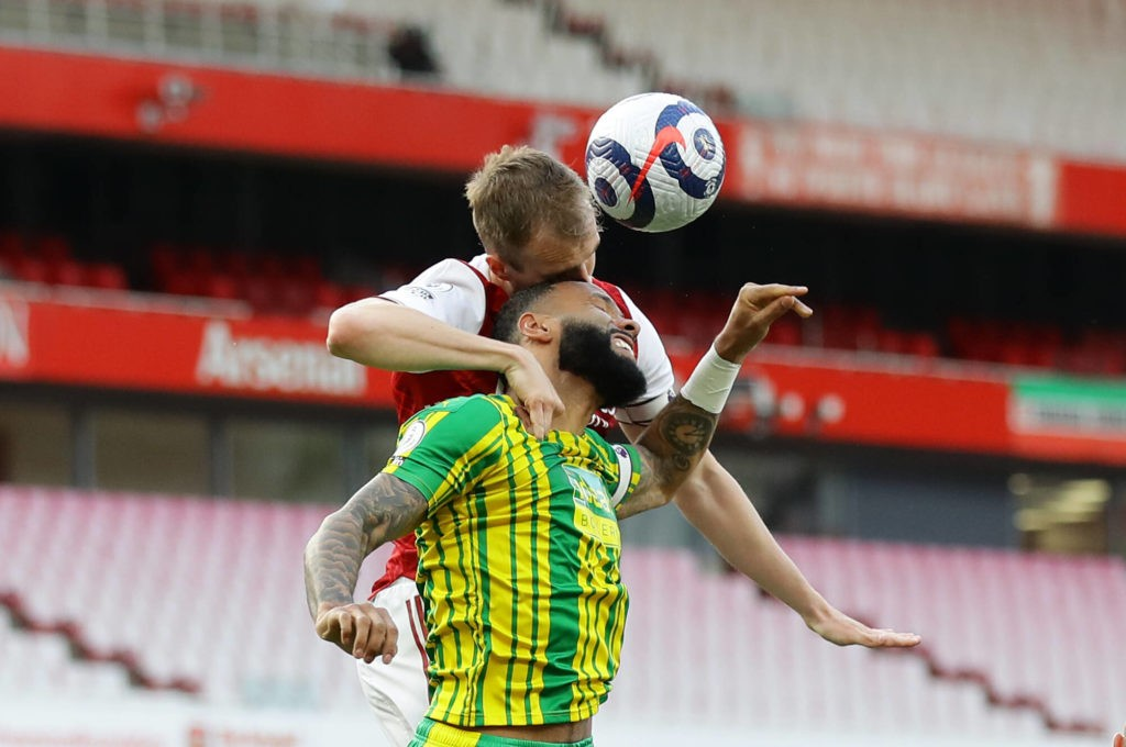 London, England, 9th May 2021. Rob Holding of Arsenal challenges Kyle Bartley of West Bromwich Albion during the Premier League match at the Emirates Stadium, London. Picture credit: David Klein / Sportimage