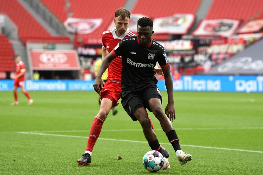 Berlin's Marcus Ingvartsen and Leverkusen's Edmond Tapsoba compete for the ball on 15/05/2021 at BayArena in Leverkusen. Copyright: Christopher Neundorf / Kirchner-Media