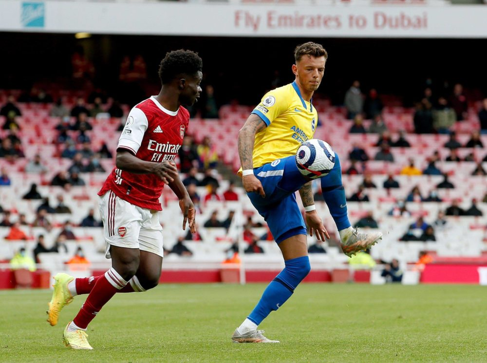 Ben White of Brighton and Hove Albion controls the ball watched by Bukayo Saka of Arsenal - 23/05/2021. Copyright: Matt Impey / Shutterstock