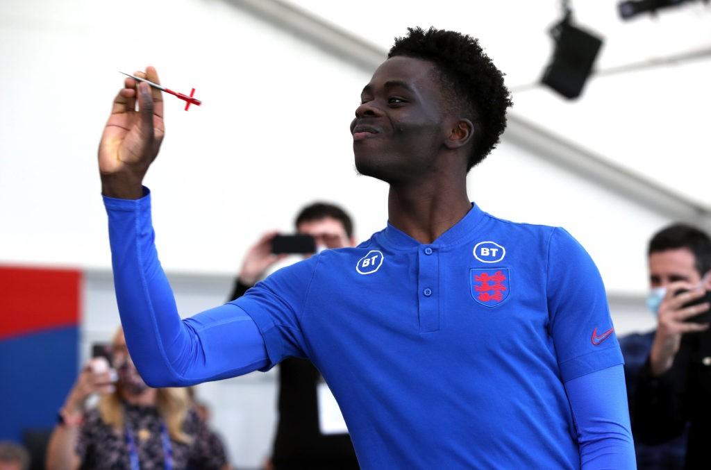 England's Bukayo Saka plays darts with media following the press conference at St George s Park, Burton upon Trent. Copyright: Nick Potts
