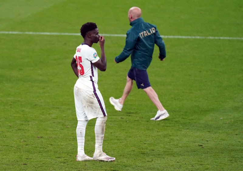 Bukayo Saka stands dejected after missing from the penalty spot during the shoot out following the UEFA Euro 2020 Final at Wembley Stadium, London. Picture date: Sunday July 11, 2021. Copyright: Mike Egerton