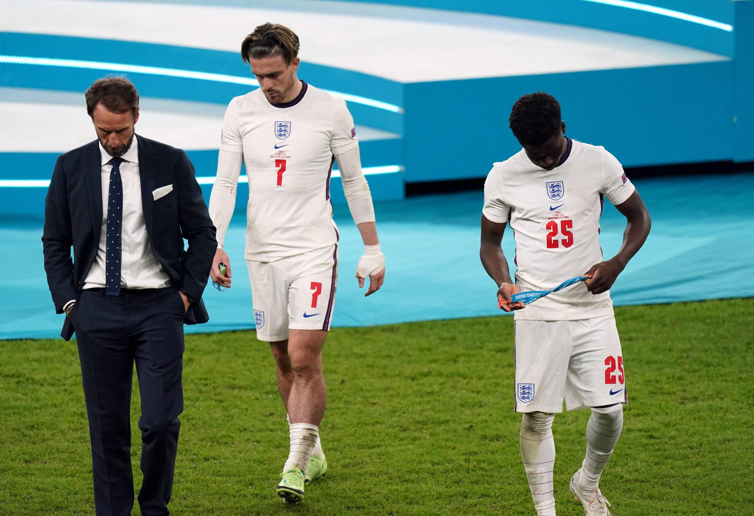 Italy v England - UEFA EURO 2020 Final - Gareth Southgate stands dejected alongside Bukayo Saka and Jack Grealish following the UEFA Euro 2020 Final at Wembley Stadium, London. Picture date: Sunday, July 11, 2021. Copyright: Mike Egerton