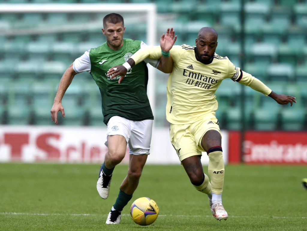 Hibernian v Arsenal - Pre Season Friendly - Easter Road Arsenal s Alexandre Lacazette right and Hiberninan s Alex Gogic battle for the ball during the pre-season match at Easter Road, Edinburgh. Picture date: Tuesday July 13, 2021. Copyright: Ian Rutherford