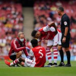 Emirates Stadium Arsenal s Thomas Partey centre receives treatment on the pitch during The Mind Series match at Emirates Stadium, London. Picture date: Sunday August 1, 2021. rivalry.Copyright: Aaron Chown