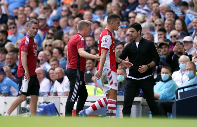 Manchester City v Arsenal - Premier League - Etihad Stadium Arsenals Granit Xhaka walks past manager Mikel Arteta after being sent off during the Premier League match at the Etihad Stadium, Manchester. Picture date: Saturday August 28, 2021. Copyright: Nick Potts