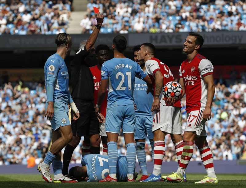 Manchester, England, 28th August 2021. Granit Xhaka of Arsenal is shown a red card by referee Martin Atkinson during the Premier League match at the Etihad Stadium, Manchester. Picture credit should read: Darren Staples / Sportimage