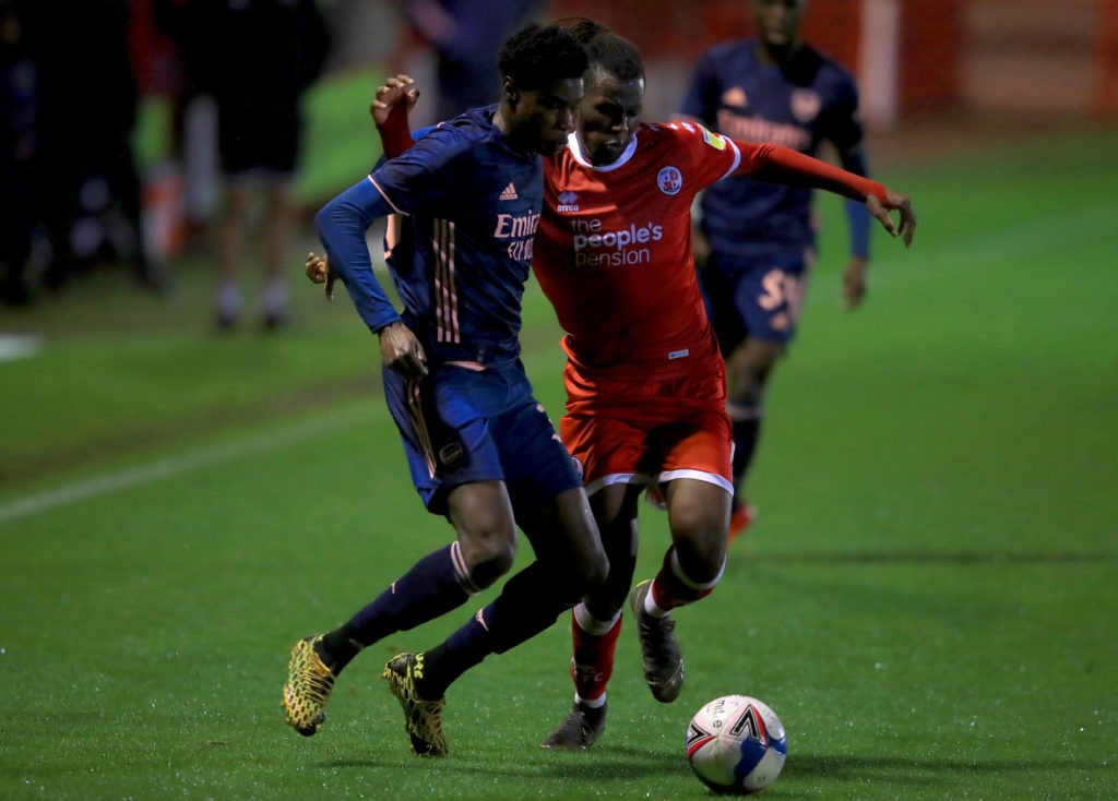 Arsenal U21's Ryan Alebiosu (left) and Crawley Town's David Sesay battle for the ball during the EFL Trophy Southern Group B match at The People's Pension Stadium, Crawley. Copyright: Adam Davy