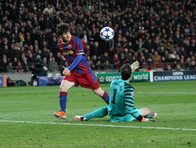 Barcelona FC s Lionel Messi ON His Way to Scoring His sides Opening Goal Lifts The Ball Over Arsenal FC London s Manuel Almunia UEFA Champions League 2nd Leg Load 16 Barcelona v Arsenal FC London 8th March 2011 Copyright imago