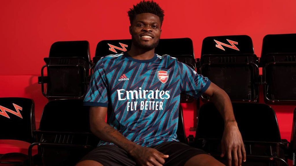 Thomas Partey modelling the new Arsenal third kit for 2021/22 (Photo via Arsenal.com)