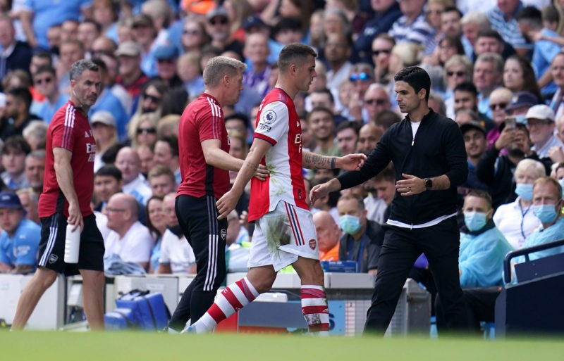 Manchester City v Arsenal - Premier League - Etihad Stadium Arsenals Granit Xhaka walks past manager Mikel Arteta after being sent off during the Premier League match at the Etihad Stadium, Manchester. Picture date: Saturday August 28, 2021.