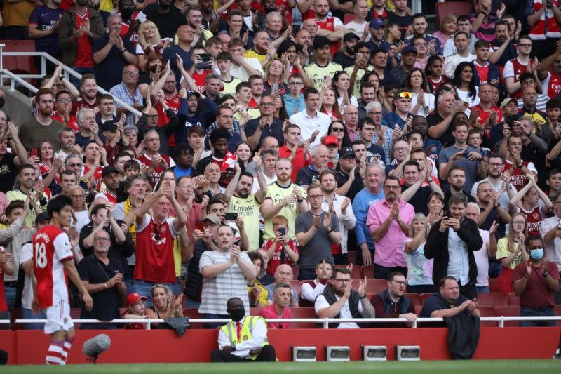 Arsenal fans applaud Takehiro Tomiyasu A at the EPL match Arsenal v Norwich City, at the Emirates Stadium, London, UK on 11th September, 2021.