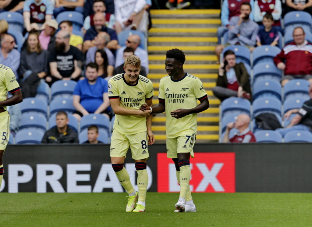 Football - 2021 / 2022 Premier League - Burnley vs. Arsenal Martin Odegaard of Arsenal celebrates with Bukayo Saka after he curls a free kick around the Burnley wall to put his team 1-0 ahead in the first half, at Turf Moor. COLORSPORT/ALAN MARTIN