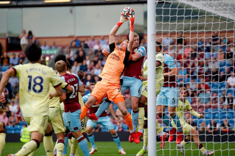 Arsenal goalkeeper Aaron Ramsdale 32 claims a corner under pressure during the Premier League match between Burnley and Arsenal at Turf Moor, Burnley, England on 18 September 2021. Burnley Turf Moor Lancashire England Copyright: Simon Davies