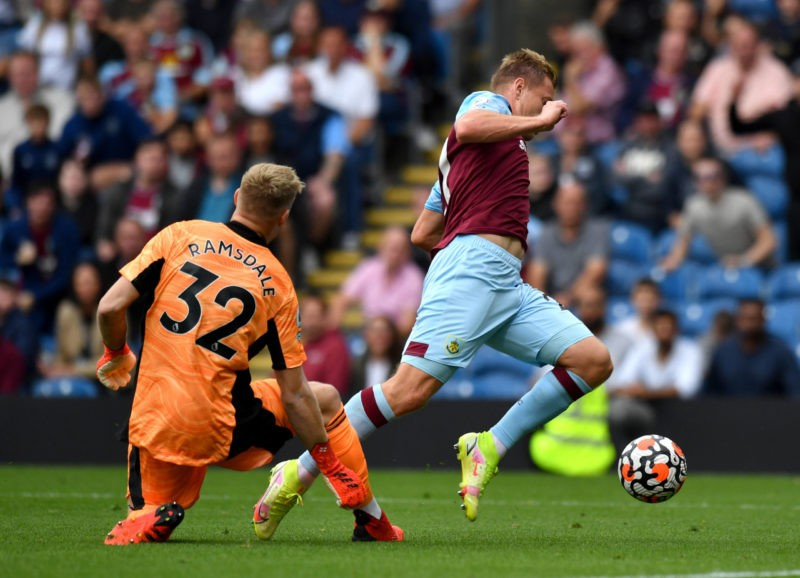 Turf Moor Arsenal goalkeeper Aaron Ramsdale left and Burnley s Matej Vydra battle for the ball during the Premier League match at Turf Moor, Burnley. Picture date: Saturday September 18, 2021. Copyright: Anthony Devlin