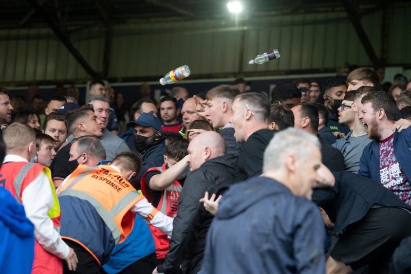 Trouble breaks out at full time between Arsenal left and Burnley right supporters following the Premier League match at Turf Moor, Burnley Copyright: Russell Hart