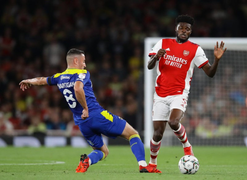 London, England, 22nd September 2021. Thomas Partey of Arsenal tackled by Anthony Hartigan of Wimbledon during the Carabao Cup match at the Emirates Stadium, London. Picture credit should read: David Klein / Sportimage SPI-1207-0016