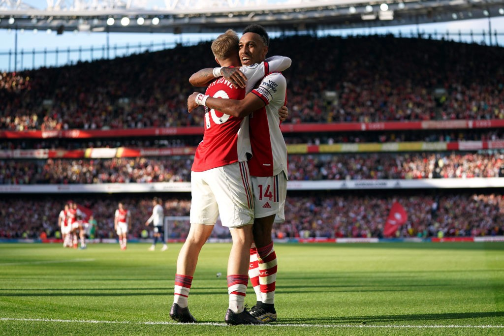 Arsenal v Tottenham Hotspur - Premier League - Emirates Stadium Arsenals Pierre-Emerick Aubameyang celebrates scoring their side s second goal of the game with team-mate Emile Smith Rowe left during the Premier League match at the Emirates Stadium, London. Picture date: Sunday September 26, 2021.