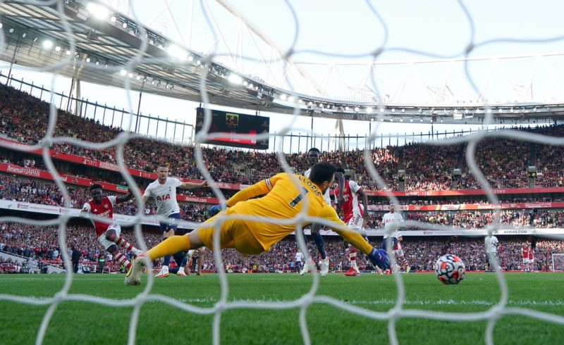 Arsenal v Tottenham Hotspur - Premier League - Emirates Stadium Arsenal s Bukayo Saka scores their side s third goal of the game during the Premier League match at the Emirates Stadium, London. Picture date: Sunday September 26, 2021.