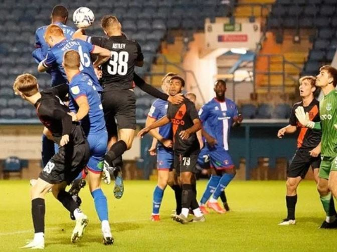 Jonathan Dinzeyi rises highest to meet a header for Carlisle United (Photo via carlisleunited.co.uk)