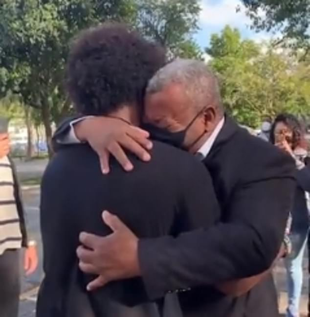 Willian embraces his father after returning home