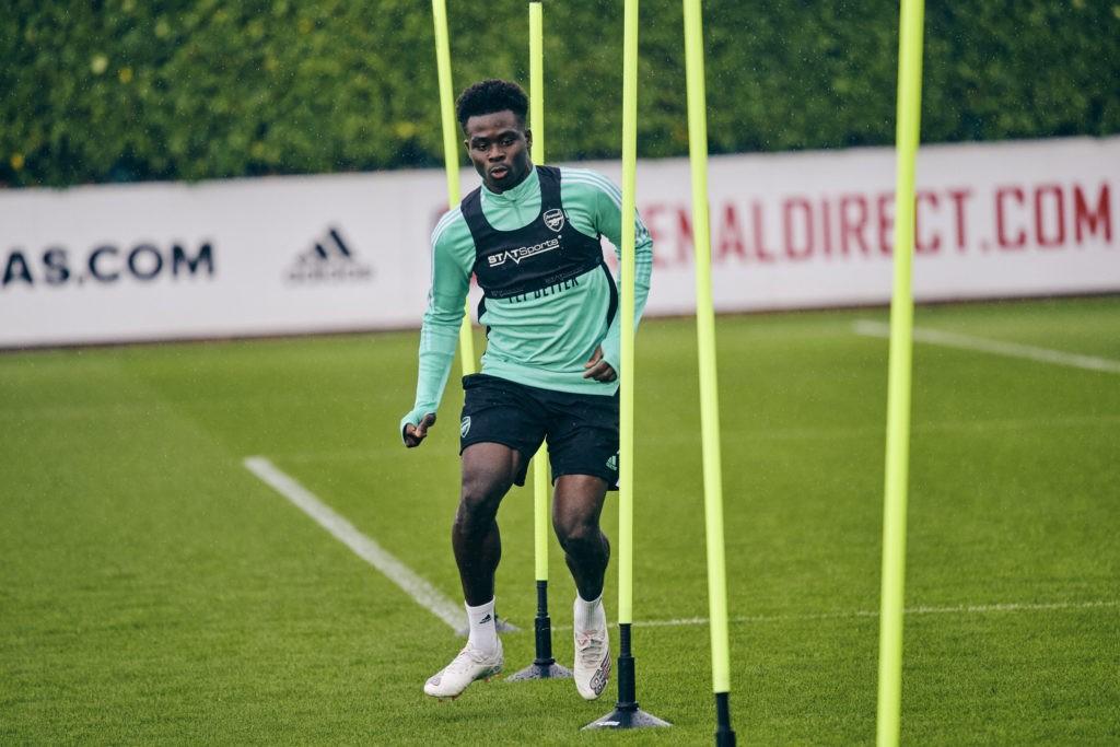 Bukayo Saka wearing a STATSports vest in training