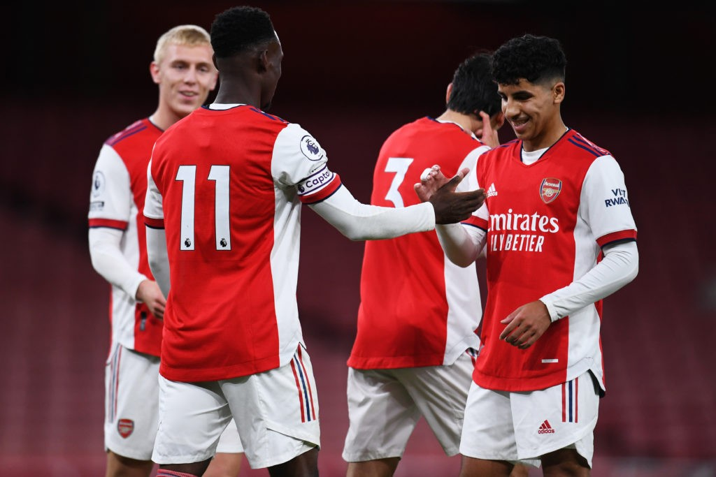 LONDON, ENGLAND: Flo Balogun of Arsenal celebrates with teammate Salah Oulad M'Hand after scoring the team's first goal during the Premier League 2 match between Arsenal U23 and Brighton & Hove Albion U23 at Emirates Stadium on October 01, 2021. (Photo by Alex Burstow/Getty Images)