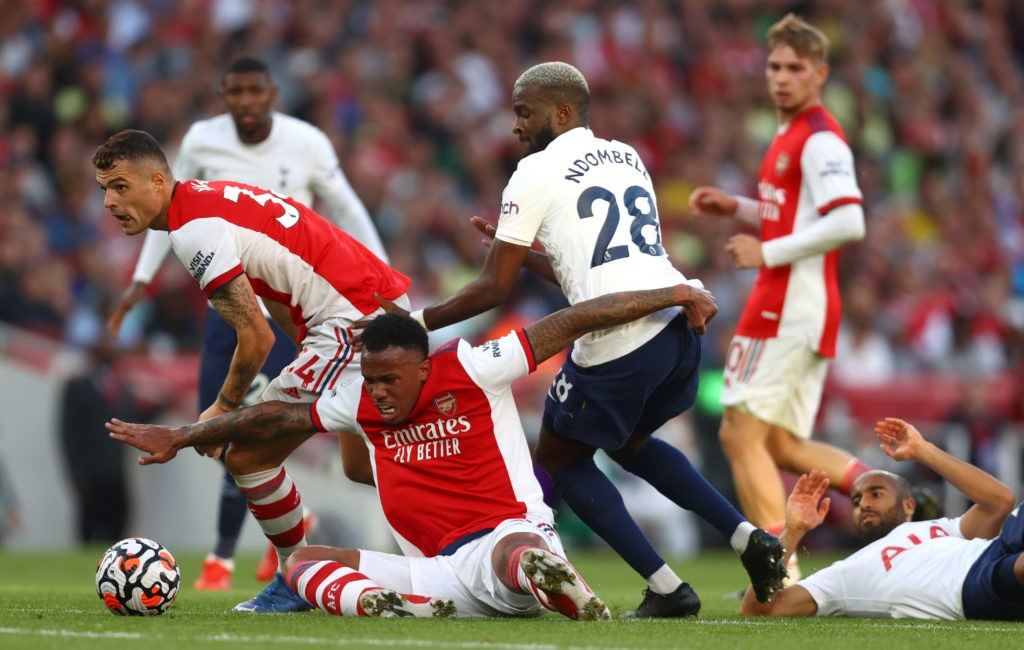 LONDON, ENGLAND - SEPTEMBER 26: Tanguy Ndombele of Tottenham Hotspur battles for possession with GranitXhaka and Gabriel Magalhaes of Arsenal during the Premier League match between Arsenal and Tottenham Hotspur at Emirates Stadium on September 26, 2021 in London, England. (Photo by Clive Rose/Getty Images)