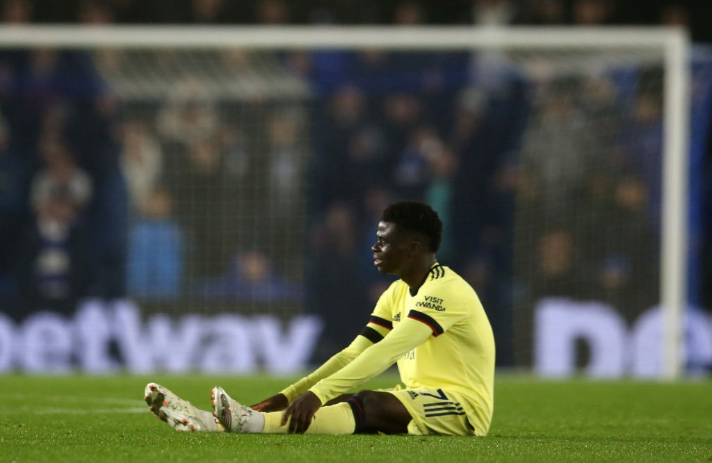 BRIGHTON, ENGLAND: Bukayo Saka of Arsenal suffers an injury during the Premier League match between Brighton & Hove Albion and Arsenal at American Express Community Stadium on October 02, 2021. (Photo by Steve Bardens/Getty Images)
